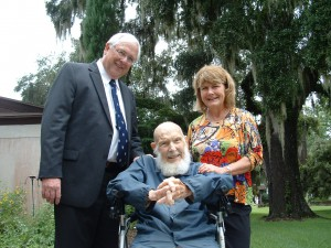 Fr. Christian with his nephew, Dan Stacey and Dan's wife Eve at Fr. Christian's 100th birthday celebration.